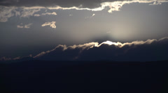 Timelapse, sunset sun and clouds vanish Stock Footage