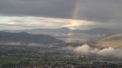 Weather, morning rainbow over city, aerial Stock Footage