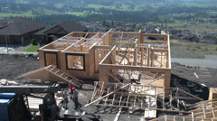 Stock Video Footage of construction, time-lapse rafters going on house