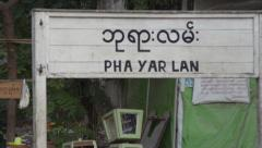 ASIAN TRAIN: Sign in Burmese and English on Platform Stock Footage