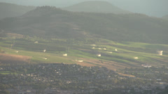 Time-lapse, distant sprinklers on hill, these are 120' reach powerful sprinklers Stock Footage