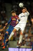 Gerard Pique(L) of FC Barcelona vies with Sergio Ramos(R) of Real Madrid Stock Photos