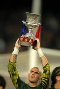 Victor Valdes of FC Barcelona holds Supercup trophy - stock photo