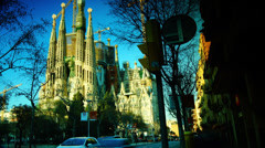 Cathedral Sagrada Familia famous church and landmark with traffic cars Stock Footage