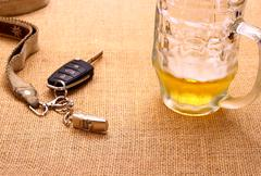 Car key with a tilted trailer and beer mug Stock Photos