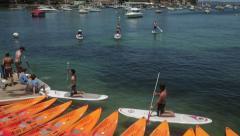 Paddle boarding, manly wharf, sydney, australia Stock Footage