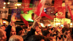 Crowd of people waving Turkish flags outside Stock Footage