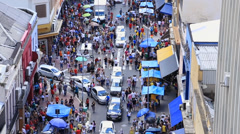 Hundreds of People walk along the 25 March area in Sao Paulo, Brazil. Stock Footage