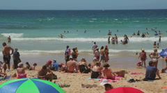People sunbathing on manly beach, sydney, australia Stock Footage