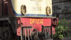 TRAIN - LOCOMOTIVE: Close up train passing, pan to follow - stock footage