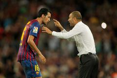 Guardiola trainer of FC Barcelona gives orders to Sergio Busquets Stock Photos