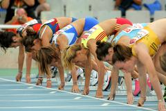 Athletes ready on the start of 100m - stock photo