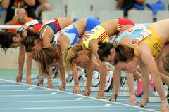Athletes ready on the start of 100m Stock Photos