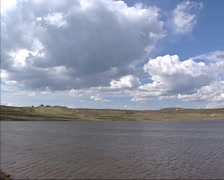 ROROS area - Cumulus clouds above lake in mining area Storwartz gruve, Stock Footage