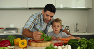 Stock Video Footage of Father showing his son different ingredients