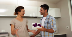 Man giving his partner a gift Stock Footage