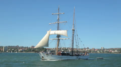 Tracking clip of tall ship in sydney harbour, australia Stock Footage