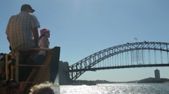 Passengers on sydney ferry, pan to harbour bridge, australia Stock Footage