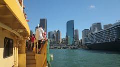 Passengers on ferry arriving at circular quay, sydney, australia Stock Footage