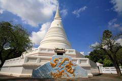 Thai white pagoda with dragon painting Stock Photos