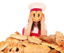 little girl cook with pretzel face - stock photo