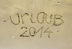 inschrift 2014 auf meer, sand, strand - stock photo