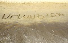Inschrift 2014 auf meer, sand, strand Stock Photos