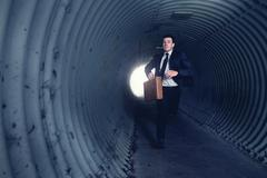 busy businessman running in a tunnel. - stock photo