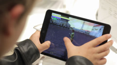 Playing Game With Ipad Air Stock Footage