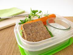 Lunchbox with wholemeal bread and carrots with yogurt dip Stock Photos