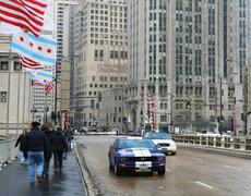 People walk on michigan avenue bridge in chicago Stock Photos