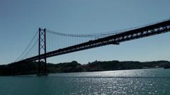 Europe Portugal Lisbon riverside 050 pass under the great bridge Stock Footage