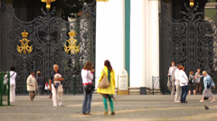 Crowd Tourists Against Hermitage Gates in St Petersburg Stock Footage