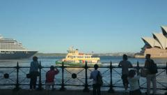 Ferry passes opera house and cruise ship, sydney, australia Stock Footage
