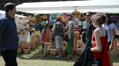 Stock Video Footage of people choose wicker baskets in crafts market fair festival