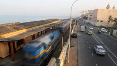 Passenger train passing through Bambalapitiya railway station Stock Footage