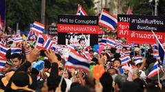 thai anti-government protesters rally to democracy monument - stock photo