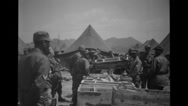 Soldiers Carrying Boxes In Military Camp Stock Footage