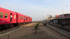 Commuter train departing Bambalapitiya railway station Stock Footage