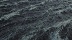 4k seamless loop, aerial view of rough stormy ocean or sea surface Stock Footage