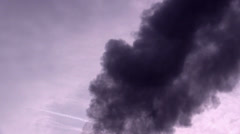 Black smoke in a sky - stock footage