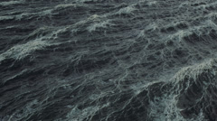 Abstract looped background seamless loop, aerial view of rough stormy ocean Stock Footage