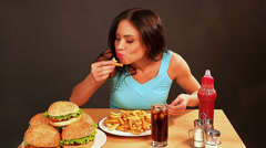 Stock Video Footage of Woman eating fast food. Time lapse