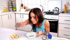 Woman dinner at kitchen. Stock Footage