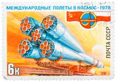 stamp printed in ussr, international flights into space, intercosmos, deliver - stock photo