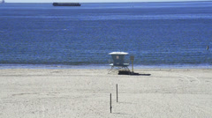 Lifeguard tower on a lonely beach Stock Footage