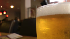 Beer in focus cold, foamy pint in pub HD Stock Footage
