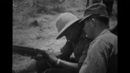 American soldier and Ethiopian soldier practicing rifle Stock Footage