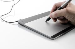 Hand writing on a touch pad Stock Photos
