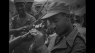 Soldier looking inside the rifle Stock Footage